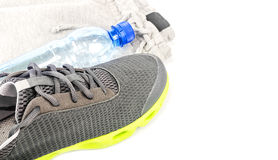 Sport shoes and water Stock Photography