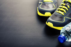 Sport shoes and water Stock Images