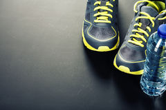Sport shoes and water Royalty Free Stock Photo