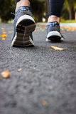 Sport shoes. A woman on the pavement. Royalty Free Stock Photos