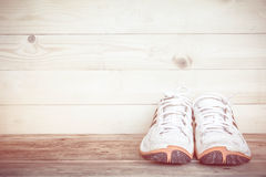 Sport shoes on a wood floor Royalty Free Stock Photo