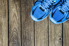 Sport shoes   on a  wooden background. Sport equipment Stock Photos