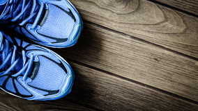 Sport shoes   on a  wooden background. Sport equipment Royalty Free Stock Images