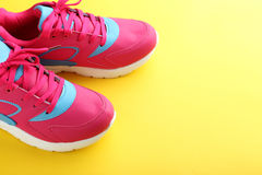 Sport shoes. On yellow background Royalty Free Stock Photography