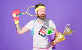 Sport shop assortment. Man bearded athlete hold sport equipment jump rope fitness mat boxing glove expander racket and. Golden goblet. Choose sport you like royalty free stock image