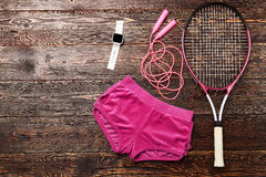 Sport shorts and badminton racket. Timer and skipping rope. Healthy life style Stock Photos