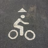Sport sigh. Bicycle sign on bike track in the park Royalty Free Stock Photo