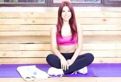 Sport slim woman begins to practice yoga. Sport and wellness concept. Slim woman begins to practice yoga. Sport and wellness concept royalty free stock images