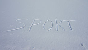 Sport in the snow written Royalty Free Stock Photo