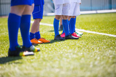 Sport soccer background. Sport background. Soccer team; Boys With Football Coach Stock Photo