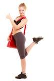 sport Sportliches Mädchen der Eignung mit der Turnhallentasche, die sich Daumen zeigt Stockfotografie