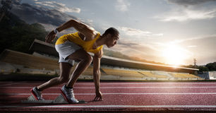 Sport. Sprinter  on the running track. Stock Photos