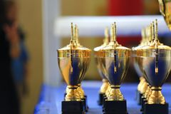 Sport stack gold trophy cup in the ring. Victory, win, decoration, champion stock photo