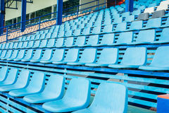 Sport stadium chair on bleachers Stock Photo