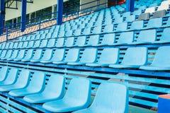 Sport stadium chair on bleachers Stock Photo