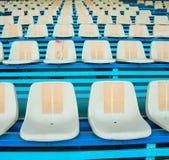 Sport stadium chair on bleachers Royalty Free Stock Image