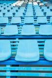 Sport stadium chair on bleachers Stock Photos
