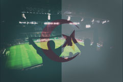 Sport stadium with fans and blending Algeria flag Stock Photo