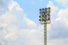 Sport stadium floodlights on a cloudy background. Soccer stadium lighting Royalty Free Stock Photography