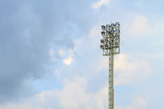 Sport stadium floodlights on a cloudy background. Soccer stadium lighting Royalty Free Stock Images