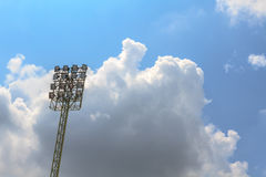 Sport stadium floodlights on a cloudy background. Soccer stadium lighting Stock Photo