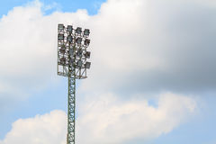 Sport stadium floodlights on a cloudy background. Soccer stadium lighting Royalty Free Stock Image