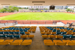 Sport stadium Plastic chairs in a row. Royalty Free Stock Image