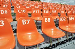 Sport stadium seat and number. Sport stadium orange seat and number Royalty Free Stock Image