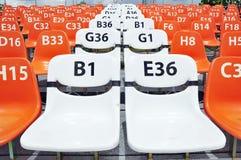 Sport stadium seat and number. Sport stadium orange seat and number Stock Photo