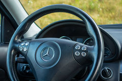 Cluj Napoca/Romania - Octomber 10, 2017: Mercedes Benz W203- year 2005, Avantgarde equipment, black metallic paint, photo session. Sport steering wheel with stock photography