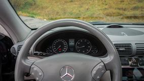 Cluj Napoca/Romania - Octomber 10, 2017: Mercedes Benz W203- year 2005, Avantgarde equipment, black metallic paint, photo session. Sport steering wheel with royalty free stock image