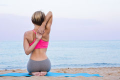 Sport stretching on the beach Royalty Free Stock Image