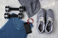 Sport stuff with fitness tracker and smartphone. On fur background stock photos