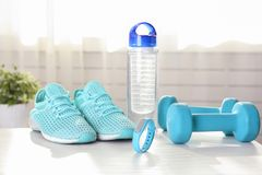 Sport stuff with fitness tracker on table. Sport stuff with fitness tracker on wooden table Royalty Free Stock Image