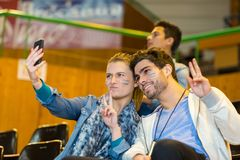 Sport supporters at stadium doing selfie. Sport supporters at stadium doing a selfie stock image