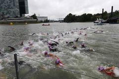 Sport swimming triathlon. A large group of female swimmers racing in a triathlon in the Media Hafen at Dusseldorf, Germany Royalty Free Stock Photos