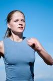 Sport teenage girl running over blue sky Stock Images
