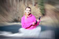 Sport teenage girl using tablet touchpad on pier Stock Images