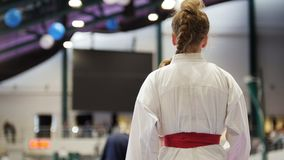 Sport teenagers - female sportsmen on karate - ready for fight Royalty Free Stock Images