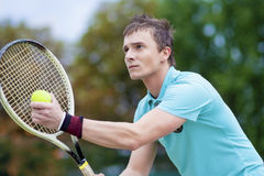Sport and Tennis Concept: Handsome Caucasian Man With Tennis Raq Royalty Free Stock Image
