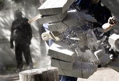 Sport time. Karate man breaking bricks outside Stock Image