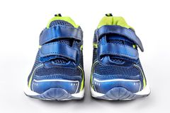 Sport trainers on white background. Blue and green sport shoes  on white background. Pair of new sport shoes Royalty Free Stock Images