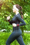 Sport Training Concept: Caucasian Brunette Woman Running Fast Stock Images