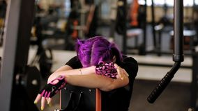 Sport training endurance woman gather strength. Sport training endurance. Tired woman gathering strength during intense workout stock footage