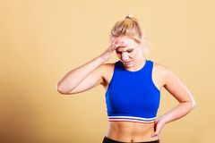 Fitness woman with headache migraine pain Stock Image