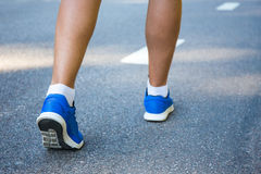 Sport or travel concept - male legs in running shoes Royalty Free Stock Photo