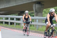 Sport triathlon cycling. A female triathlete smiling during the bike leg of the London Triathlon Stock Photography