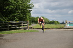 Sport triathlon cycling. A single male triathlete during the cycling leg of a triathlon at Dorney Lake, England Royalty Free Stock Photography