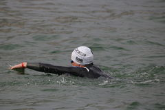 Sport triathlon swimming. A male triathlete swimming front crawl in Docklands during the London Triathlon Stock Images