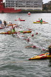 Sport triathlon swimming. Triathletes start the swim leg of a race at the London Triathlon in Docklands Royalty Free Stock Images